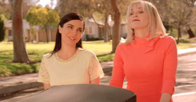 Betty (Barbara Crampton) takes Marisol (Martha Hegareda) under her wing now that she's an American...or is she?