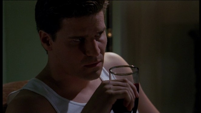 Angel drinks a glass of blood