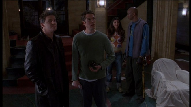 Angel fondly looks around at the hotel with Wesley, Cordelia and Gunn