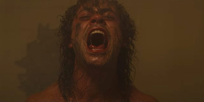 Billy, possessed by the Mind Flayer, screams in a sauna