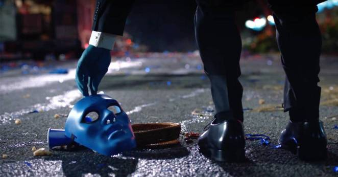Dr. M in the new HBO series picks up a blue mask off the street