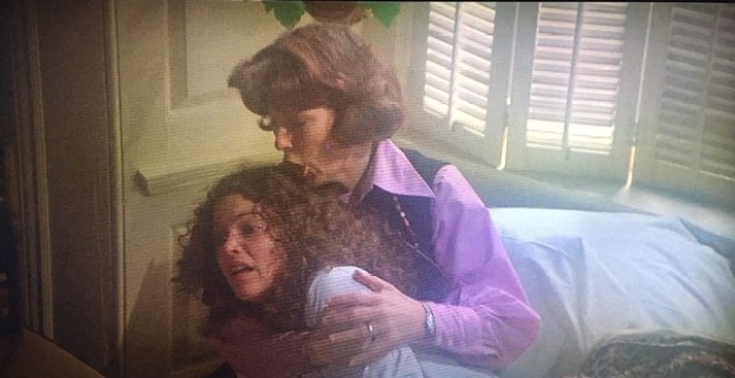 A terrified Sue Snell (Amy Irving) is comforted by her mother (Priscilla Pointer) after having a terrible nightmare in Carrie.