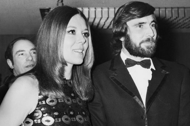 George Lazenby with a beard, with Diana Rigg at an event