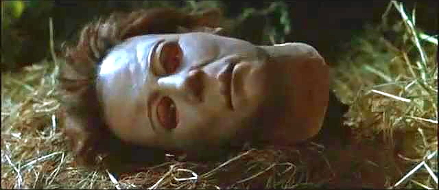 The decapitated head of Michael Myers lies on the ground