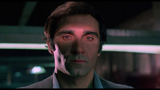 Tony Lo Bianco in God Told Me To (1976) with a pink light shining across his face