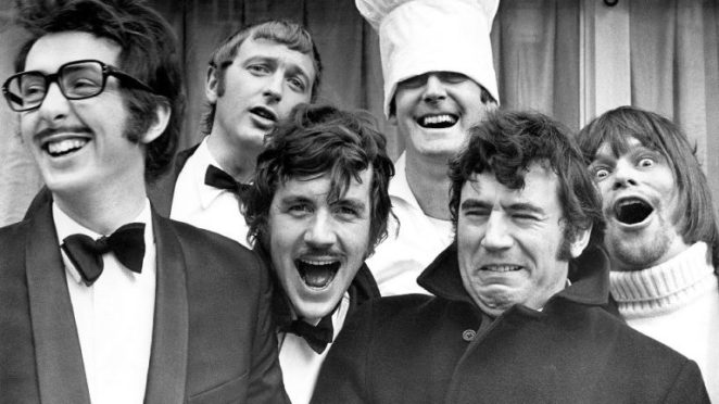 The members of Monty Python laugh and make faces