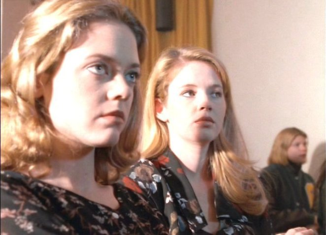 Terri and Margi look on mysteriously during their friend's funeral.