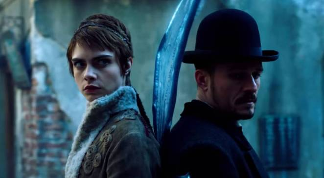 Cara Delevigne and Orlando Bloom back to back in Carnival Row from Amazon Prime.