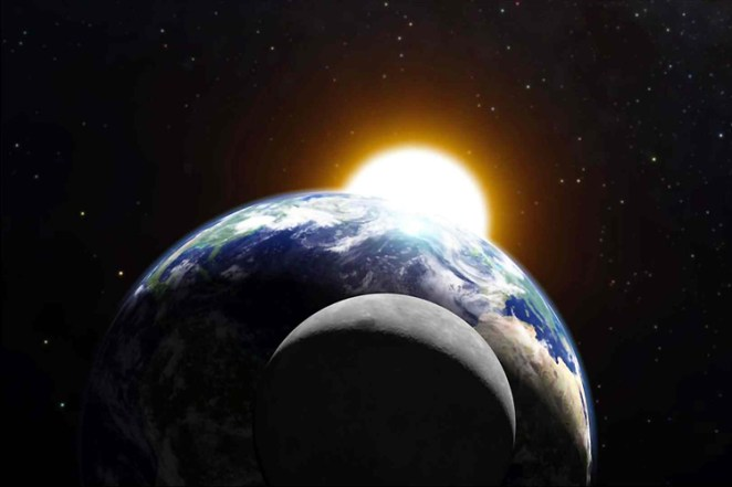 An image of the Sun, earth, and moon aligning in astronomical syzygy, in this case a lunar eclipse.