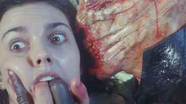 The Chatterer Cenobite forces his fingers into Kirsty's mouth