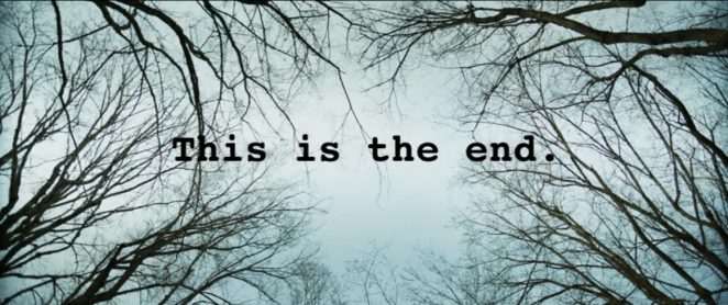 """This is the end"" appears as text amongst trees"