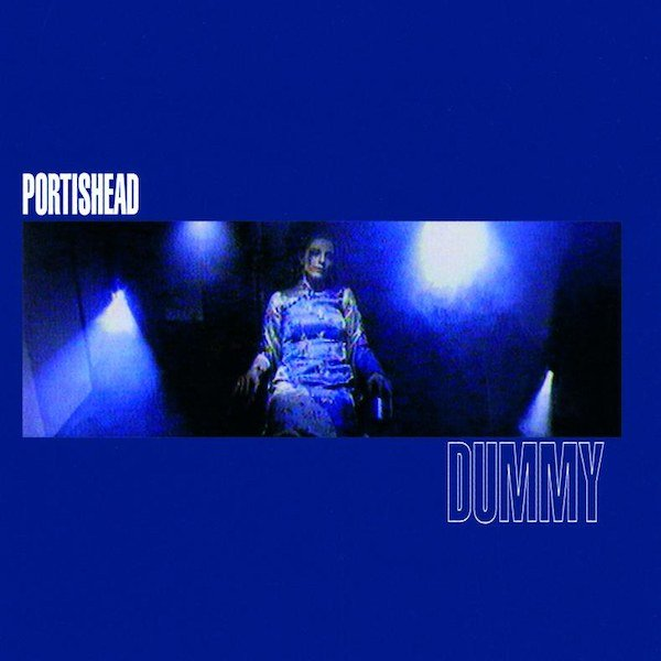The cover of Portishead's Dummy is mostly blue, with a narrow widsceen picture cutting through the center of singer Beth Gibbons looking highly enigmatic.