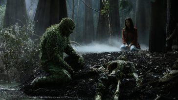 Swamp Thing looks at Holland's skeleton
