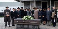 The Nakayama and Furuya families stand around the coffin of Mrs Furuya at her funeral
