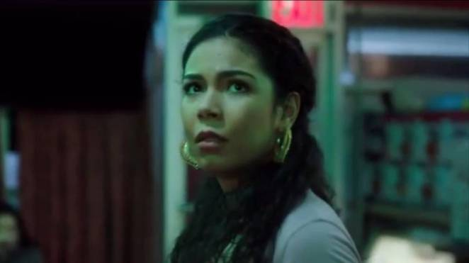 Maria Suarez looks towards the television screen, scared
