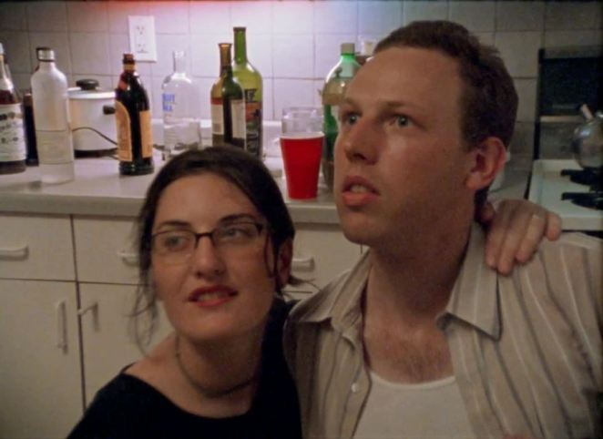 Rachel has her arm over her boyfriend Dave's shoulder at a party in Funny Ha Ha.