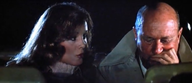 Marion Chambers discusses Micheal with Dr Loomis in the back seat of a police car.