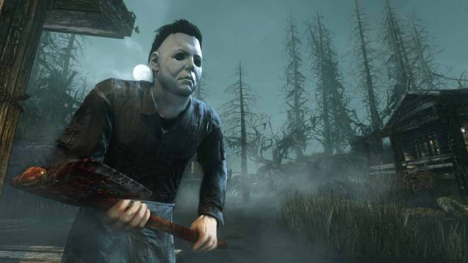 Michael Myers holding his axe in a fog filled dark wooded area