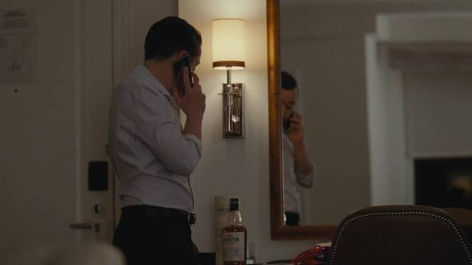Roman on the phone with his girlfriend, not aroused by her attempt at phone sex