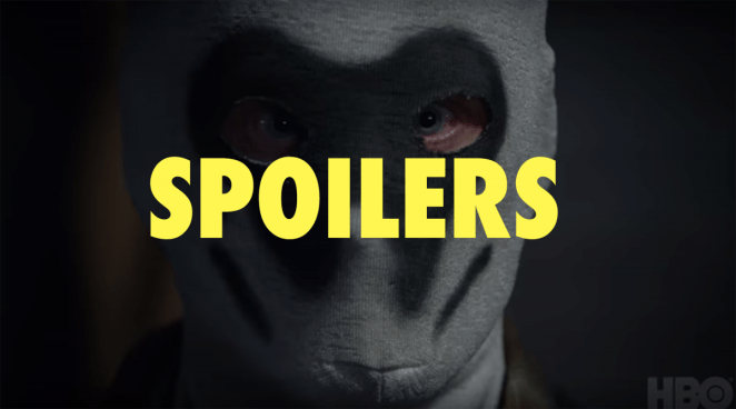 """Man in a Rorschach mask with the word """"Spoilers"""" over the face"""
