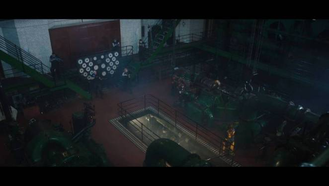 Yalalia (Michelle Fahrenheim) faces a squad of human soldiers inside the industrial setting where the film takes place.