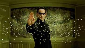Neo stops a barrage of bullets in The Matrix Reloaded