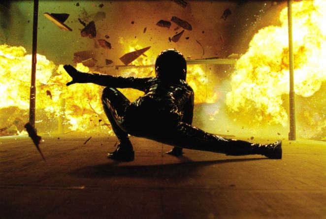 Trinity lands in front of an explosion in The Matrix Reloaded