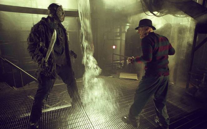 Jason vs Freddy fighting in an underground building with water pouring