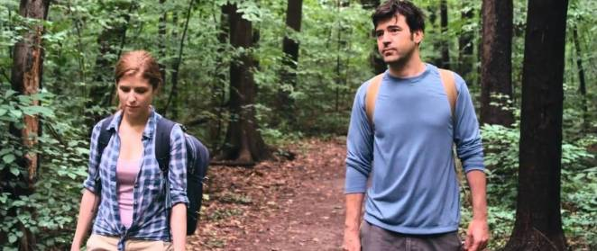 Jill (Anna Kendrick) walks with Chris (Ron Livingston) in a wood
