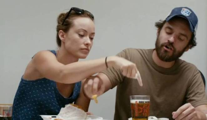 Kate (Olivia Wilde) pokes a finger in her best friend Luke's (Jake Johnson) beer while he steals a bite of her lunch.