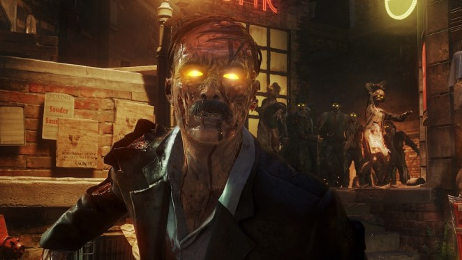 A zombie Hitler lurches toward the camera as other zombies follow behind