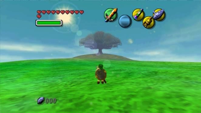 Link stands inside the moon, a serene grassy field with a tree on a hill is in the distance.