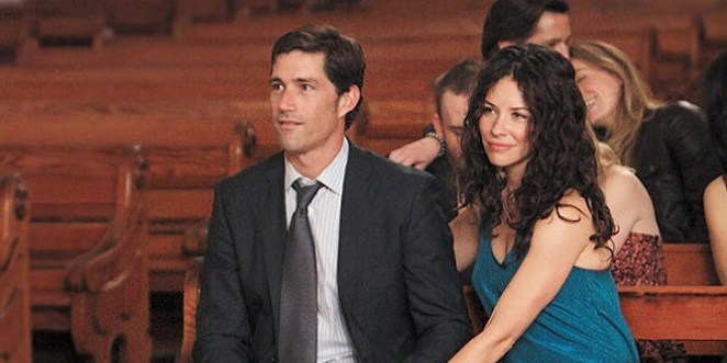 Kate and Jack sit together in a church pew
