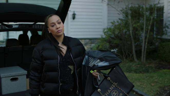 Keisha moves bags out of her car