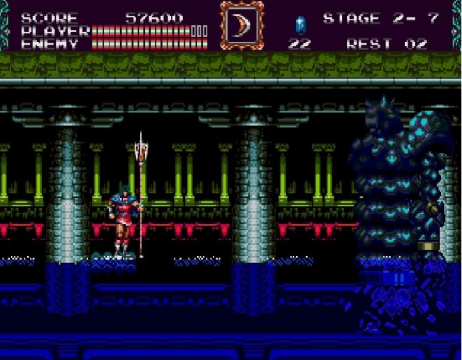 Eric battles a tall monster with long, tubular body inside a water filled ruin.