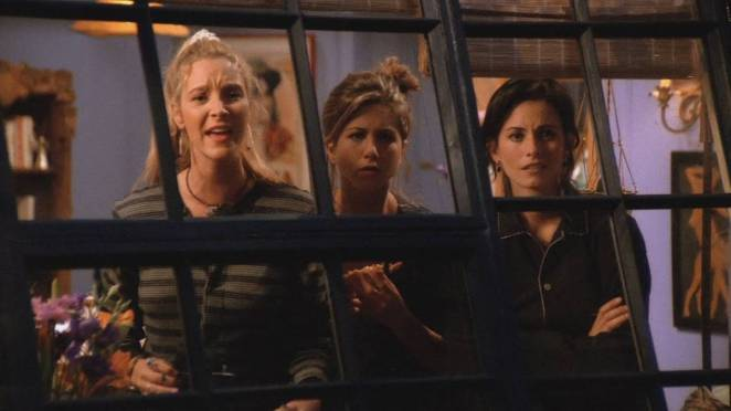 Phoebe, Rachel and Monica look out their window to try to catch a glimpse of George Stephanopoulos