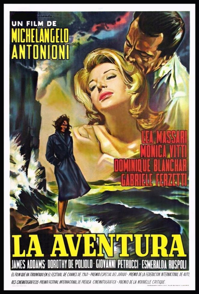A blonde socialite is embraced by a dark haired man above a mysterious woman in a dark overcoat standing on a rocky bluff