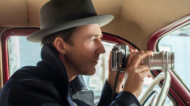 Lionel Essrog (Edward Norton) lines up his camera to shoot a person of interest from the front seat of his car.