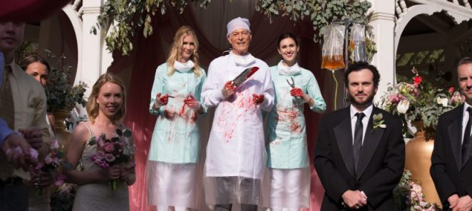 "Three of ""Mirari's"" antagonists, two nurses and the doctor, stand at a marriage altar with blood covered scrubs and surgical instruments."