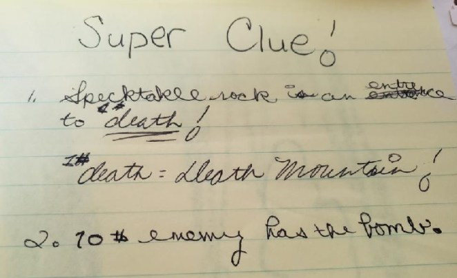 Notes from me as an 11 year old. I wrote: Super Clue! Spectacle (spelled wrong) Rock is an entrance to death! Death = Death Mountain. Number 2. 10th enemy has the bomb.