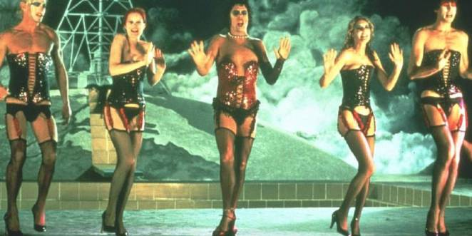 Closing number with cast of The Rocky Horror Picture Show on stage dancing in corsets