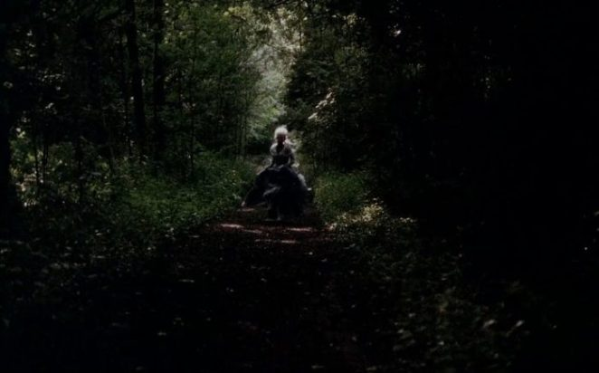 A woman running in the woods