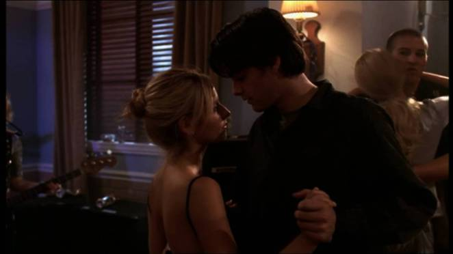 Buffy dances with Parker at a party.