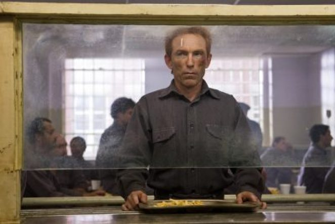 Walter Kovacs waits to be served food in prison