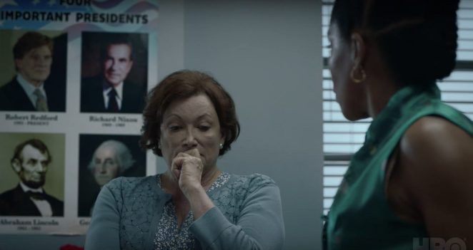 "Angela talks to Topher's teacher, the ""Important Presidents"" poster in the background"