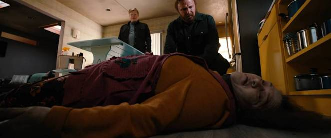 Todd stands in the background as Jesse is horrified to discover the dead body of Todd's housekeeper