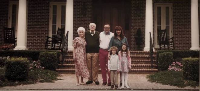 An old photo of The Armitage Family outside their mansion