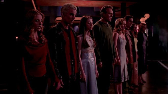 Buffy, Spike, Dawn, Giles, Anya, Xander, Tara and Willow stand hand in hand during Where Do We Go From Here