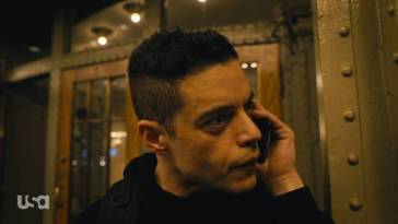 Elliot talks to Freddy on the phone outside of Grand Central