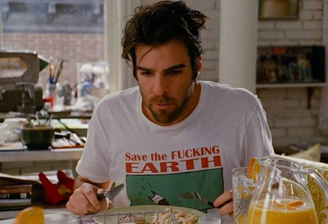 Zachary Quinto as Rick, eating breakfast and wearing a Save the Fucking Earth T-Shirt